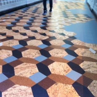 V&A's Medieval Galleries installation- natural cork, parquet pattern. collaboration btwn London's FAT Architecture and Portugal-based Amorim, world's largest producer of cork