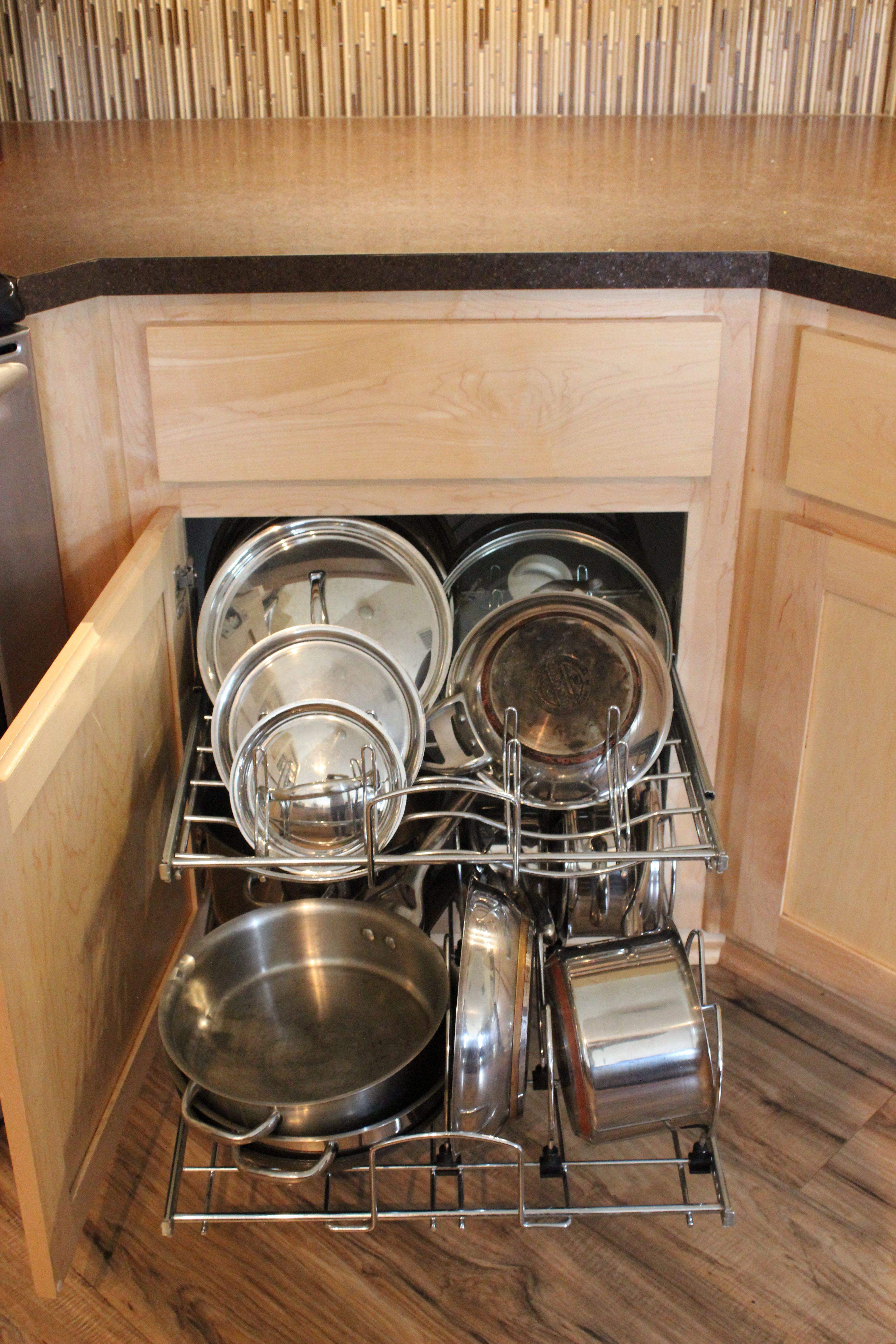 cookware pull -out, kitchen storage, chrome pots and pans storage, pots and pans pull-out